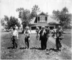 Men displaying produce grown at the Maxwell Project, Colfax County, New Mexico