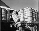 Loading bales of cotton, New Mexico