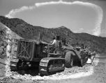 Heavy equipment working on construction  of the Taos Canyon Road (US 64), New Mexico
