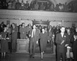 Governor Edwin L. Mechem and Mrs. Mechem entering legislature for state-of-the-state address,...