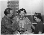 Vincent Colvert, publicity director for the Coronado Cuarto Centennial, being made up as Viceroy...