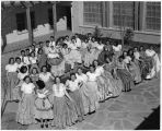 Women in fiesta and folk costume celebrating the Coronado Cuarto Centennial, New Mexico