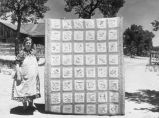 Mrs. Bill Stagg with state quilt she made, Pie Town, New Mexico