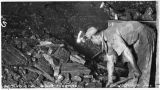 Man loading coal inside mine, Dawson, New Mexico