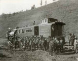 Group beside Alamorgordo and Sacramento Mountain Railroad mail car during dedication ceremony, New...