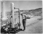 Tom Block inspecting natural gas equipment at Largo field, Mesa Verde sands production site in the...