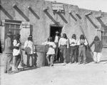 Group outside trading post and post office, Jemez, New Mexico