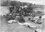 Cattlemen enjoying chuckwagon meal next to Colorado and Southern Railroad cattle cars, Clayton,...