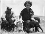 Concha Ortiz y Pino (de Kleven) and sheepherder with Caracul lambs, Jose Ortiz y Pino Ranch,...