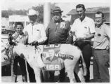 Unidentified group of men with donkey decorated with LBJ (Lyndon B. Johnson) campaign stickers,...