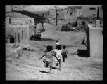 """Laguna Indian Pueblo, located 50 miles west of Albuquerque, New Mexico, children running in..."