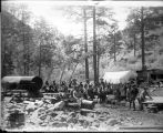 10th Cavalry troops with Indian scouts at Silver Monument Mine Camp, Chloride Creek 10 miles West...