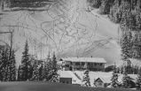 Taos Ski Valley showing ski tracks above the lodge