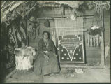 Navajo weaver Elle of Ganado and her rug for President Theodore Roosevelt