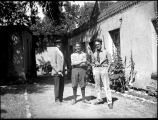 Left to right-Marsden Hartley, Randall Davey and John Sloan in the patio of the Palace of the...