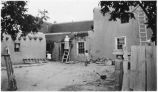 Plastering adobe walls, Cassidy Compound on Canyon Road, Santa Fe, New Mexico