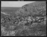 """Dog Canyon, cars, horses, cowboys and riders converge at the mouth of the canyon near..."