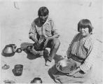 Julian and Maria Martinez displaying finished pottery, San Ildefonso Pueblo, New Mexico