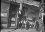 Unidentifed men in front of P.H. Doll store, Las Vegas, New Mexico