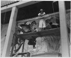 Dorothy Stewart working on Works Progress Administration mural, Albuquerque, New Mexico