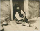 Unidentified woman making pottery, San Juan Pueblo, New Mexico
