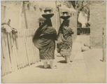 Two women carrying pots on their heads, Santa Clara Pueblo, New Mexico
