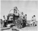Cowboys loading chuckwagon on the Bell Ranch near Wagon Mound, New Mexico