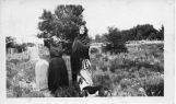 Women in the old Saint Michael's cemetery, Santa Fe, New Mexico
