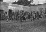 Bow and Arrow dancers from Jemez Pueblo in courtyard of Palace of the Governors, Fiesta, Santa Fe,...