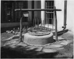 Water well in the Southwest corner of the courtyard following reconstruction, Palace of the...