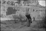 Apache woman with carrying basket