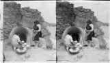 Women baking bread in horno oven, Laguna Pueblo, New Mexico