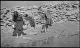 Navajo and Hopi women at waterhole, Arizona (?)