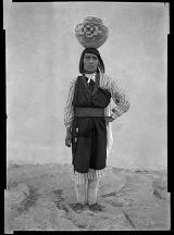 Unidentified woman with pottery on her head, Laguna Pueblo, New Mexico