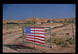 Flag on rural gateway, Navajo Nation, New Mexico
