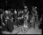 Archbishop Byrne and clergy meeting with Taos Pueblo dancers at Saint Catherine's School, Santa...