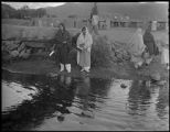 Women getting water from the stream, Taos Pueblo, New Mexico