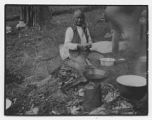 Santiago Naranjo cooking outside, Santa Clara Pueblo, New Mexico