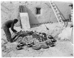 Julian Martinez firing pottery, San Ildefonso Pueblo, New Mexico