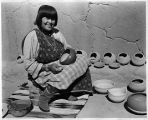 Maria Martinez polishing pottery, San Ildefonso Pueblo, New Mexico