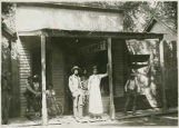 Group on porch of T.C. Long Store, Hillsboro, New Mexico