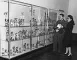 Unidentified soldier and Mela Martin viewing Laboratory of Anthropology display, Santa Fe, New...