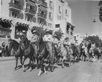 Riders on horseback in front of La Fonda Hotel, Fiesta, Santa Fe, New Mexico