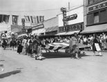 Native American women carrying United States flag in parade, Gallup Ceremonial, New Mexico