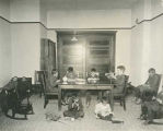 Boys playing in small sitting room, Blind Institute, Alamogordo, New Mexico