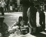 Pueblo Indians selling crafts on Palace of the Governors portal, Fiesta, Santa Fe, New Mexico