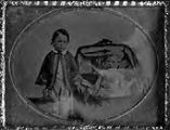 Untitled (3/4 length standing boy holding hat, other hand on carriage, 3/4 length girl seated in...