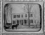 Untitled (white 2 story house with horse and buggy in front)