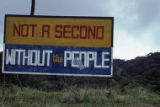 "Sign: ""Not a Second Without the People,"" Grenada"