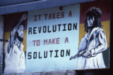 "Sign: ""It Takes a Revolution to Make a Solution,"" Grenada"